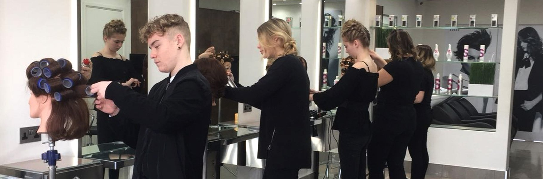 Trainee Hairdressers at the Forresters Training Academy