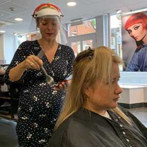 Colour going on and stylist using visor protection at Forresters Abingdon hairdressers