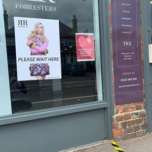 Signage for clients to see where they need to stand and wait outside Forresters Thatchan hairdressers