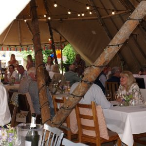 summer garden party group inside marquee