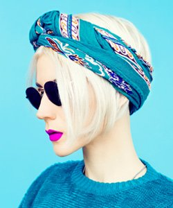 model with head scarf wrapped around her head in a tredy style